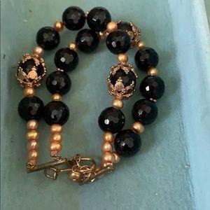 Double row black beaded bracelet.